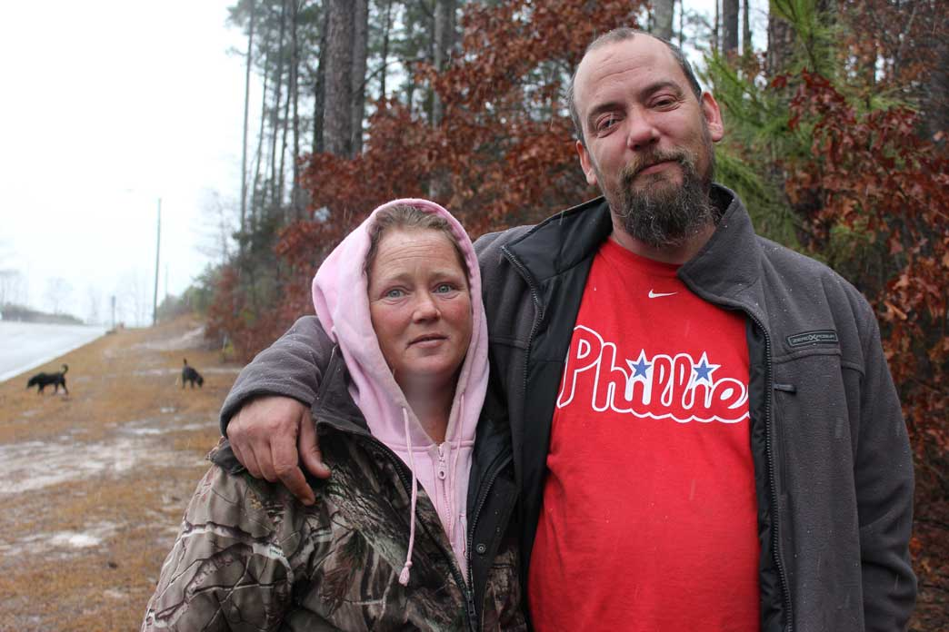 Kimberley and Christopher Moore live in the woods. Although they receive disability, the payments alone do not provide enough money to meet their needs. (Staff photo by Caitlin Owens)