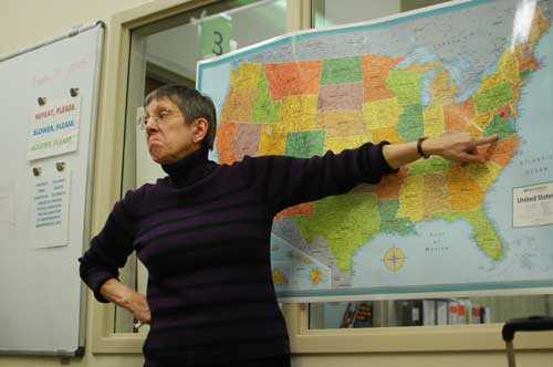 Teacher Susan Murphy points to one of the original Thirteen Colonies, quizzing her students during the beginning of class. (Staff photo by Elizabeth Byrum)
