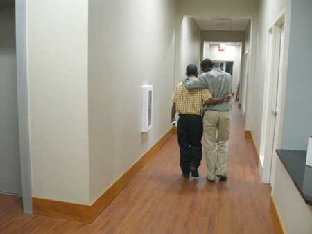 Two men walk down the new halls of the Center for Hope. (photo: Marissa Peterson)