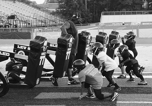 Players from the Titans Cadet Division going through drills during a recent practice at O'Kelly-Riddick Stadium. (Staff photo by Tevin Stinson)