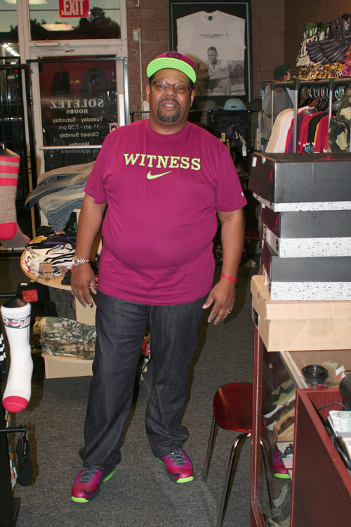 Sneaker collector Mr. Harper wears his LeBron James 10 Raspberry sneakers and matching gear. (Staff Photo by Ikendia Dixon)