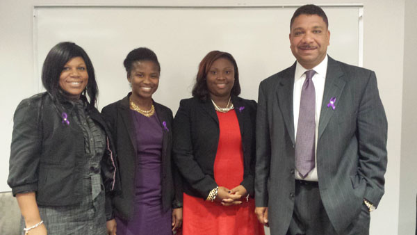 Panelists at the recent NCCU law school panel sport their purple domestic violence awareness ribbons. From left to right: Professor Deria Hayes, Attorney Monica Burnette, Attorney Stephanie Robinson, Attorney Ralph Frasier. (Photo by India Wagner).