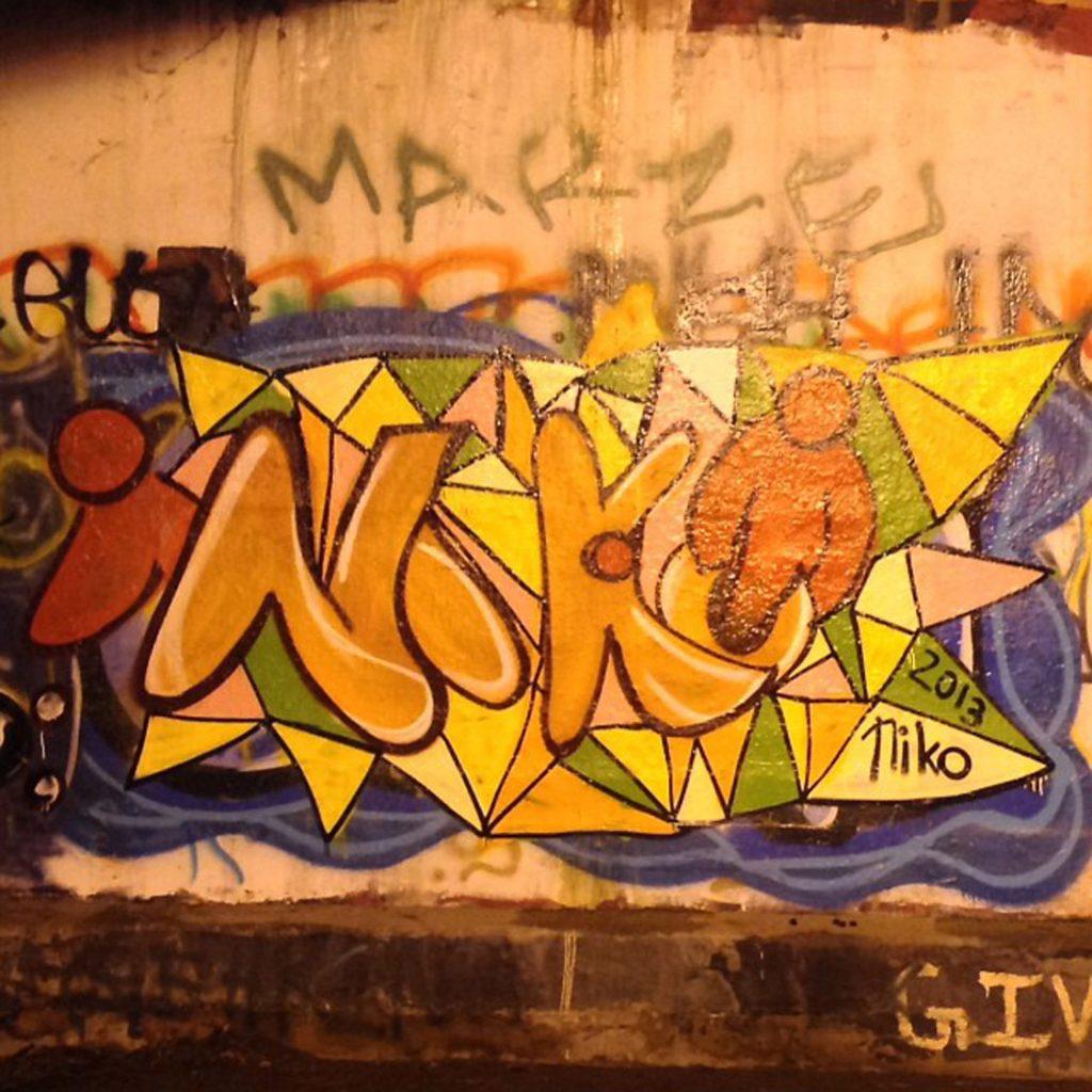 Niko writes his name in the Duke Free Expression Tunnel. (Staff Photo by Ikendia Dixon)