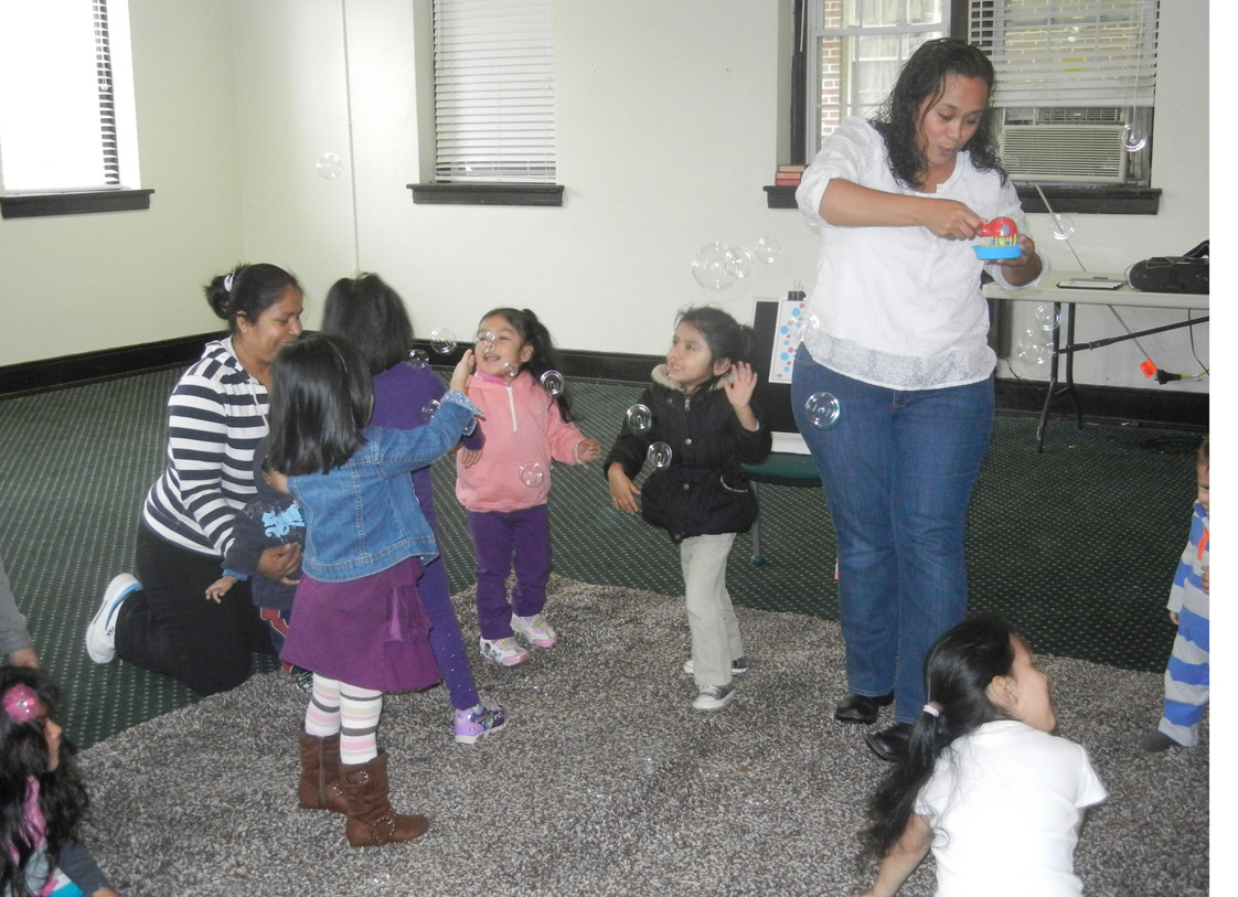 Patty Melendez has some fun after reading Spanish-language stories and brings out some bubbles for the kids to enjoy. Everyone tried to pop the bubbles as they floated through the air.
