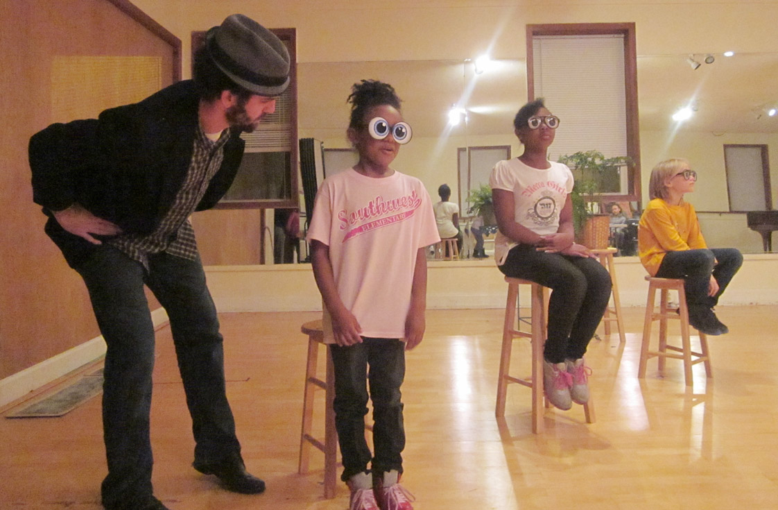 "Actor Max Rose (most left), who plays Bugsby Bramblethorn in ""Indigo Blue,"" rehearses a scene with Journi Grice, 6; Chelsea Rose, 10; and Jaxon Hardin, 8 (left to right)."