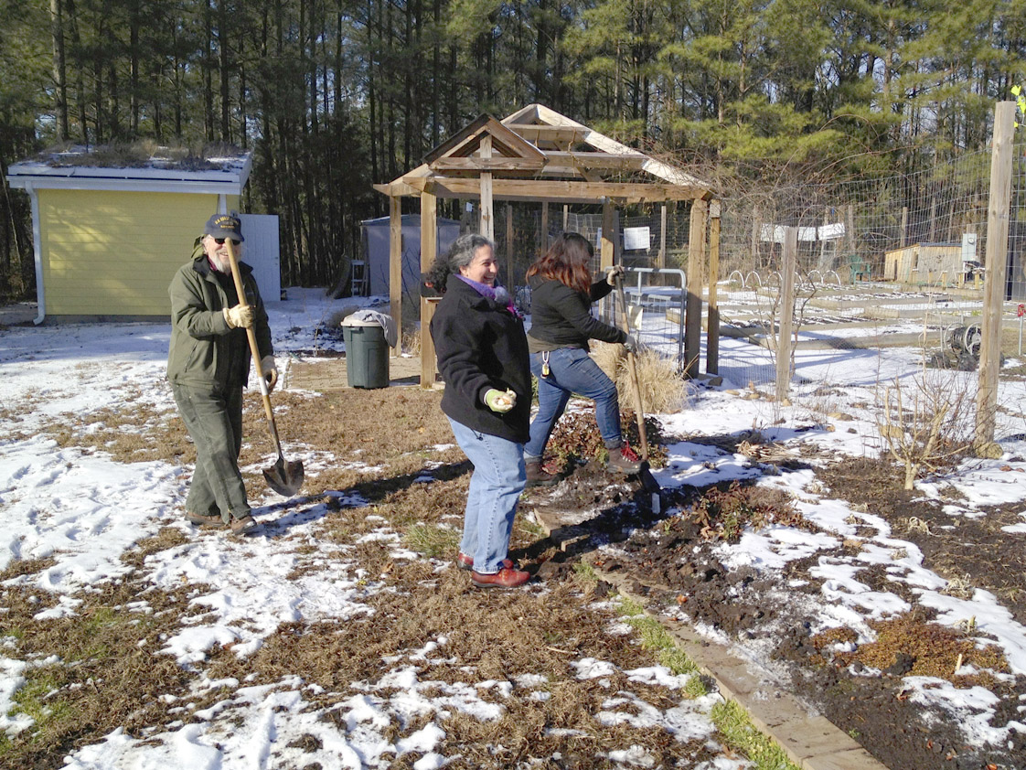 The volunteer coordinator Sally Parliers, Michelle Wallace and a volunteer work to preserve the garden during winter by checking the soil and planting produce for the spring.