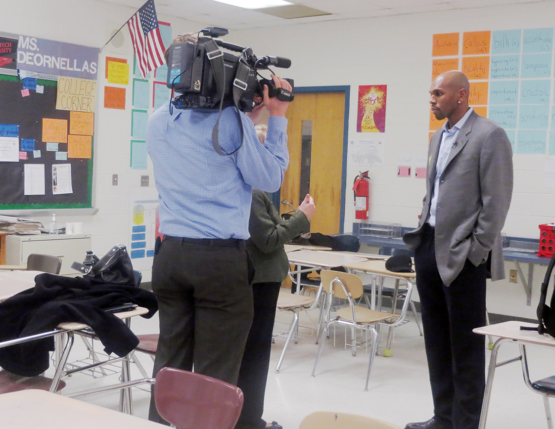 Former Tarheel basketball star, pro basketball player and NBA TV analyst Jerry Stackhouse recently visited Hillside to film a commercial for the Carolina College Advising Corps. The CCAC is an UNC-Chapel Hill program that through well-trained advisors, close in age and with similar circumstances, help underrepresented students find the best college fit for them. Courtesy of The Hillside Chronicle