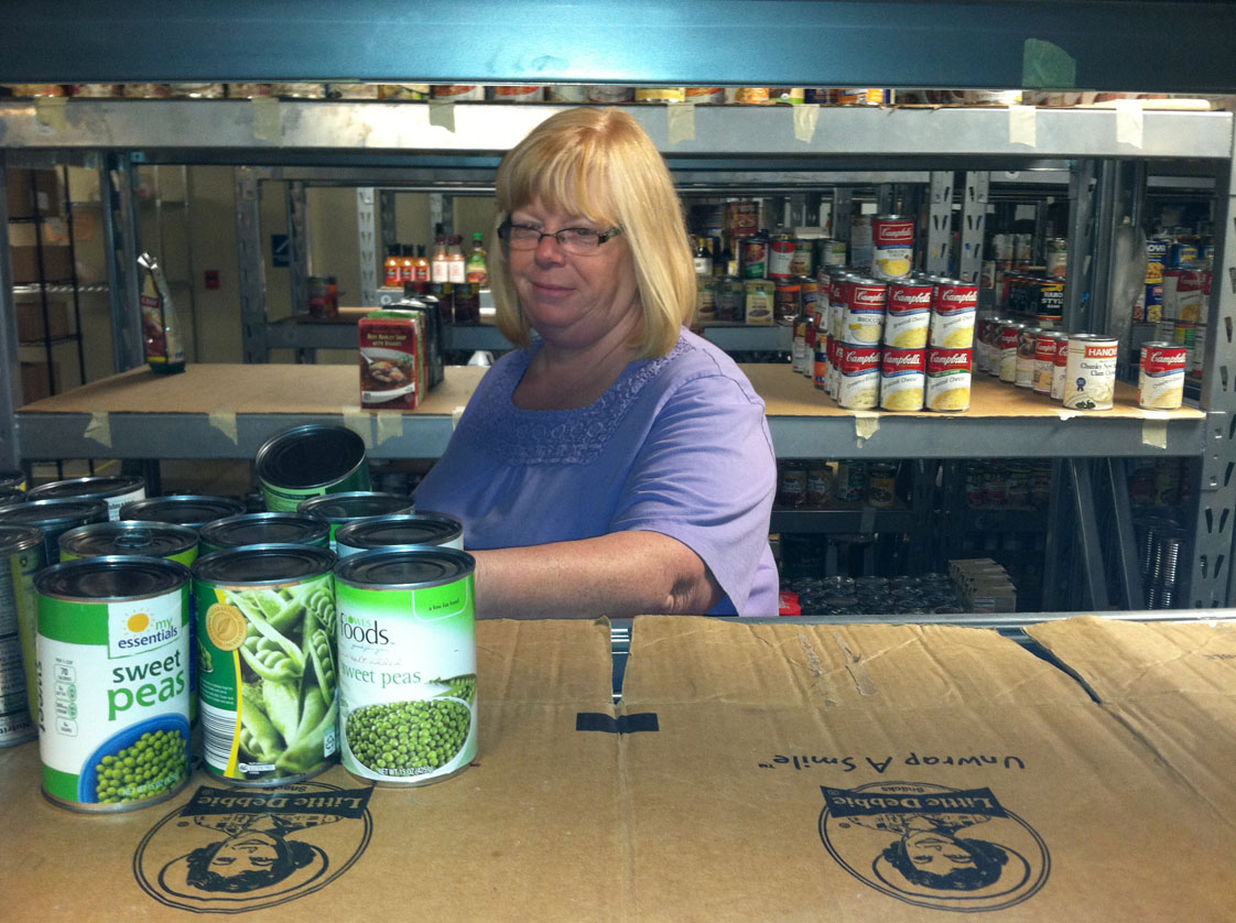 Carla Peake goes through the Center For Hope's food stores after the storm. Even when the shelves are filled, the food goes quickly. Peake says it takes upwards of fifty cans of green beans for a single meal. Staff Photo by Zach Potter