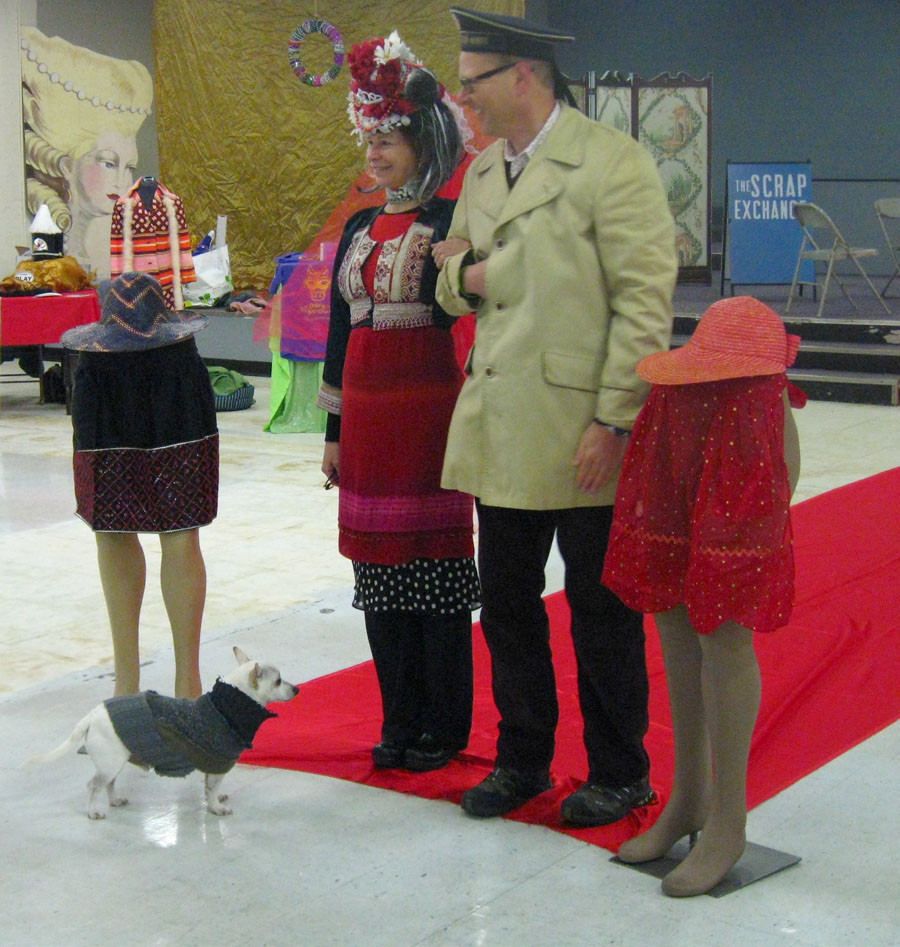 Wearing Eastern European garb of various sorts, David Goodman and Allen Meredith goose-step like soldiers down the runway in a miniature fashion show.