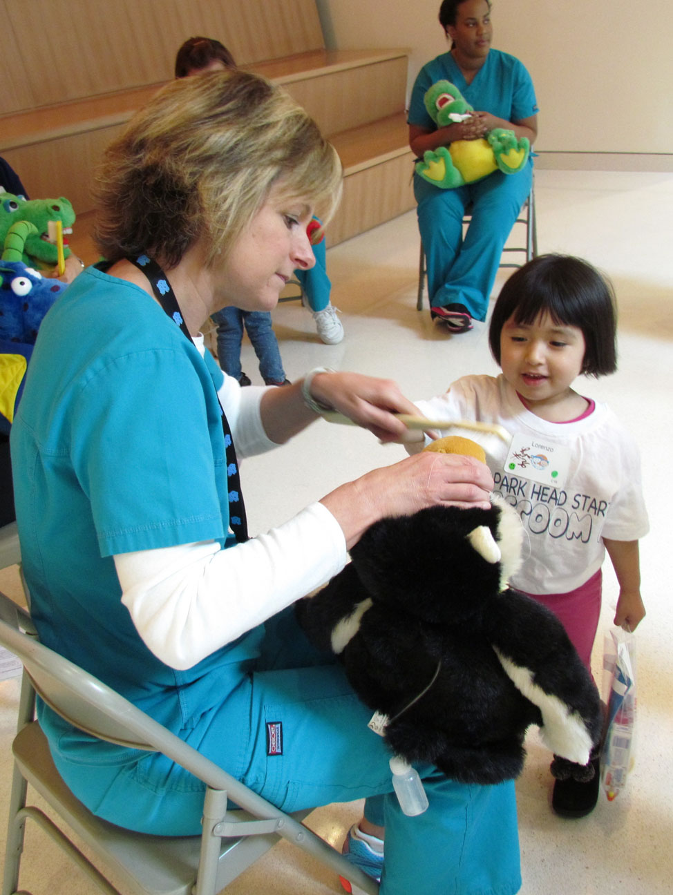 UNC School of Denistry student Jill Wilson shows Princess Lorenzo how to use proper brushing techniques. (Staff photo by Lynsay Williams)