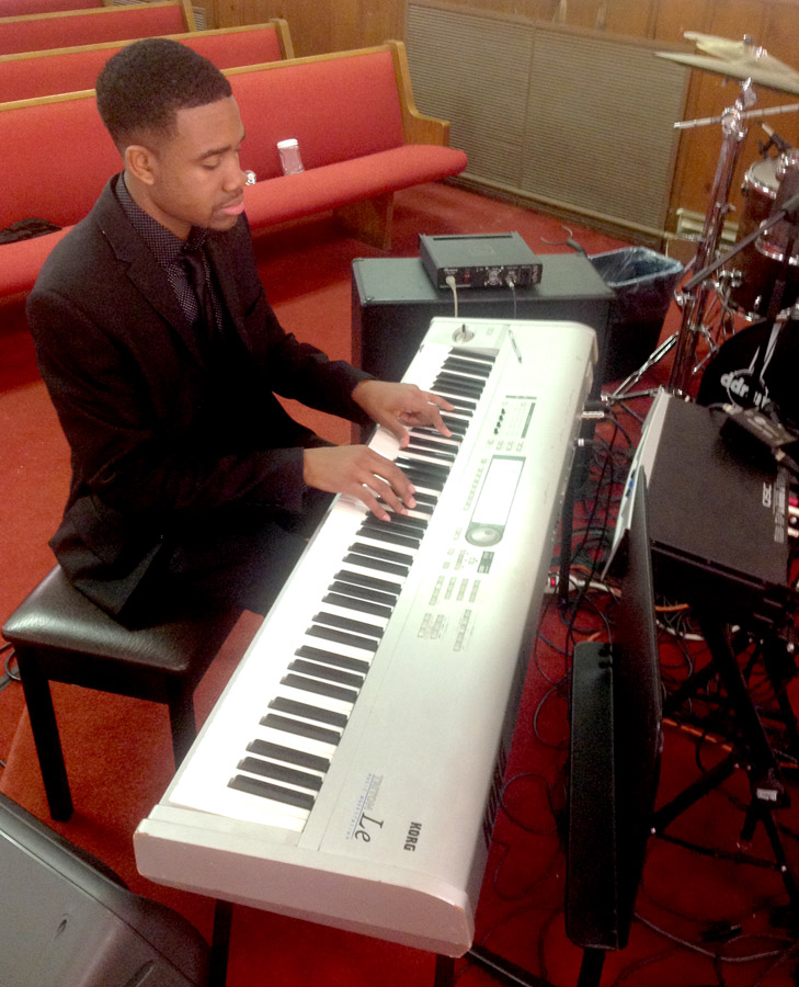 Youth Pastor Reggie Boney performs on the piano during a church service. Photo courtesy: Dennis Meeks