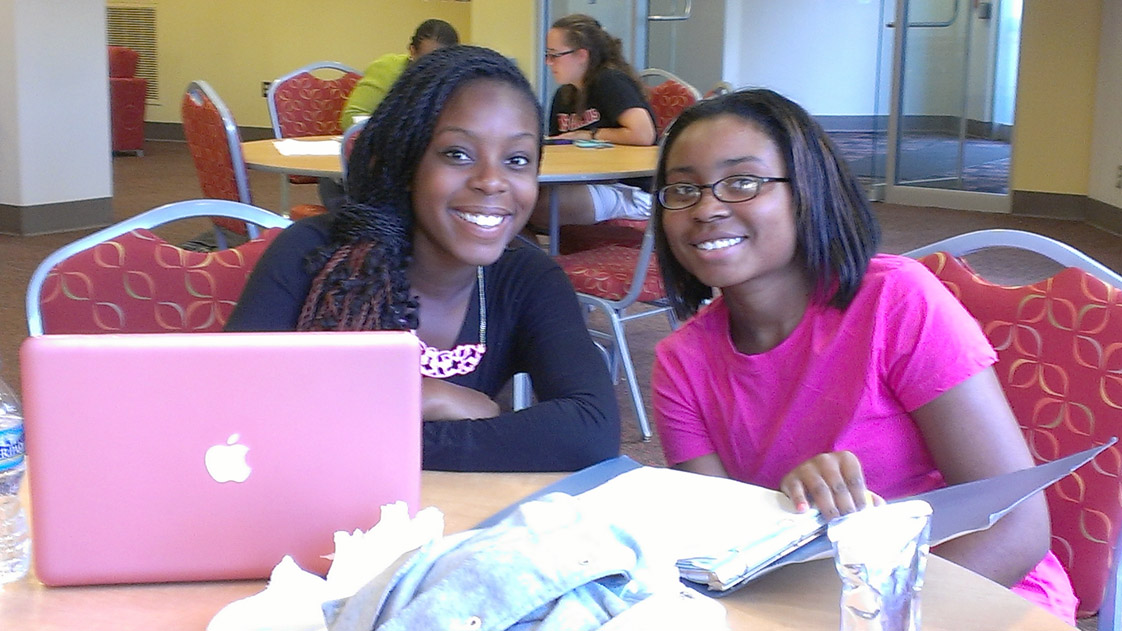 Partners for Youth tutor Asraiel Harewood (left) and program participant Kieara Chambers (right) work together at an afternoon tutoring session. (Photo courtesy of Julie Wells, executive director, Partners for Youth)