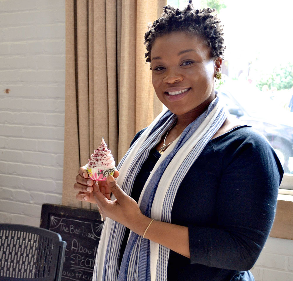 Kimberly Thigpen of The Bath Place, poses for a picture with one of her creations