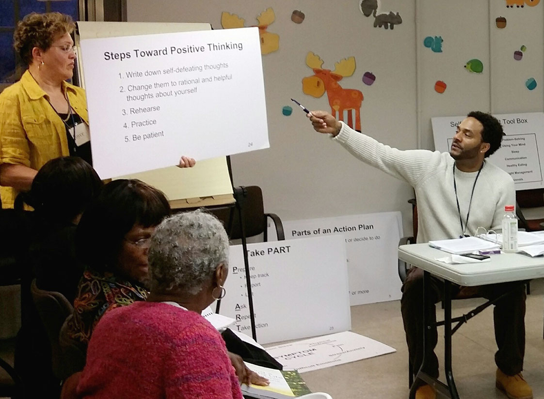"""Facilitator Michael Scott, with the Durham County Department of Public Health Department, gives insight on """"Steps Toward Positive Thinking"""" for the last session of the Wellness Workshop for Living with Chronic Diseases and Illnesses. -- Photo Courtesy of Brittney Cherry."""