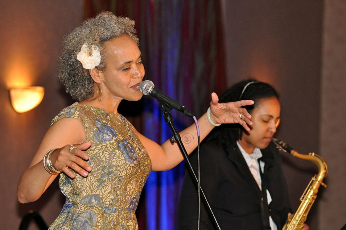 Gina Breedlove performs at the We Are 1 Conference in 2013 Harlem Renaissance Formal Dinner and Dance. Photo Courtesy of Alex Childs of AJC Photography, Atlanta, GA.