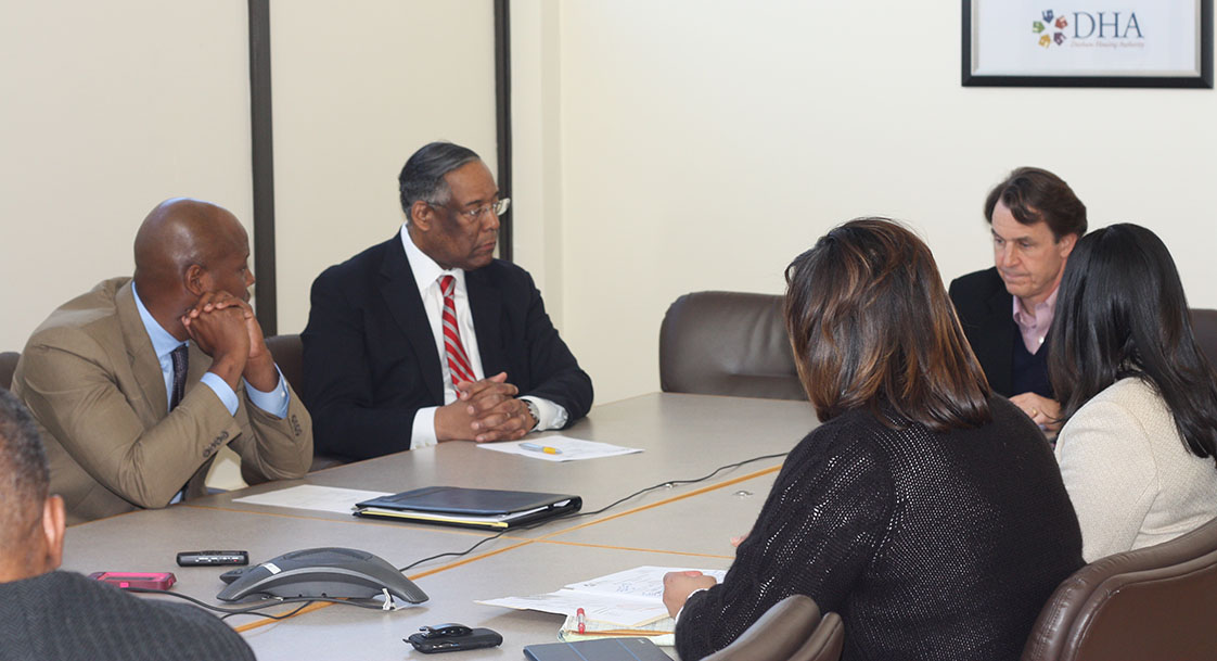 Dallas Parks (center) meets with the Durham Housing Authority's development committee to review plans for the Goley Point Development. Parks is CEO of the Durham Housing Authority. Photo Courtesy of Christopher Moore.