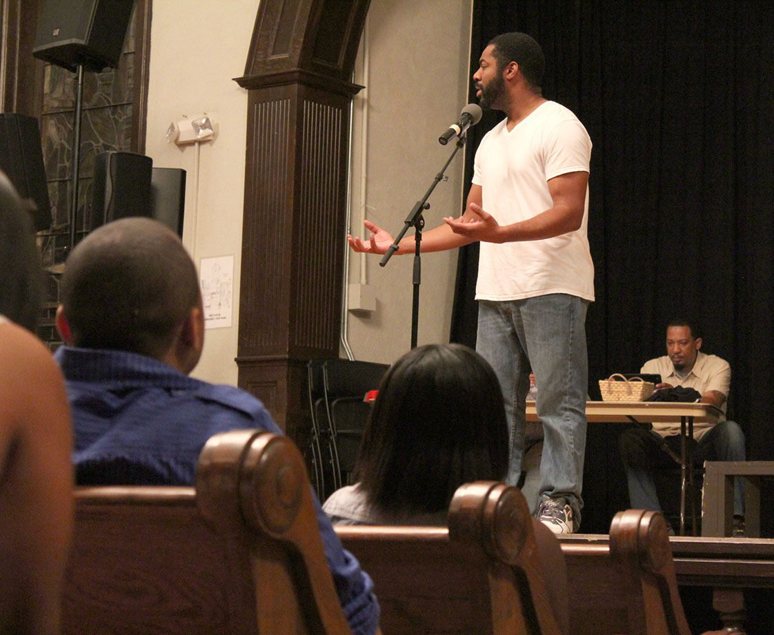 "Eric ""Lyrically Blessed"" Thompson performs a piece at September's Jambalaya Soul Slam—a spoken word competition held every month at the Hayti Center to determine who will represent Bull City Slam in regionals and nationals. Lyrically Blessed, also known as LB, competed with Bull City Slam this summer and helped the team win regionals for the first time in three years."