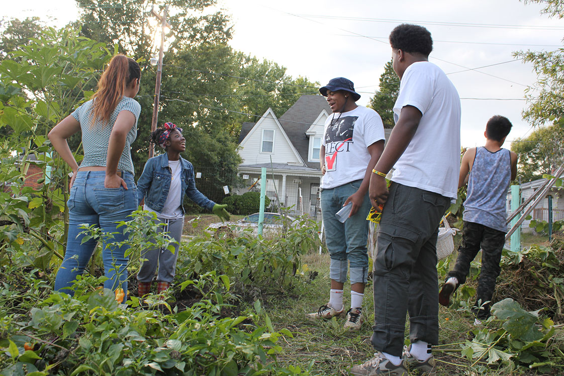 From left to right, Samantha Trejo, Latasha McMillan, Javonte Carver, Lawrence Fields, and Josue Lopez take a break from harvesting for a moment to chat in the DIG garden. (Staff photo by Mary Alta Feddeman)
