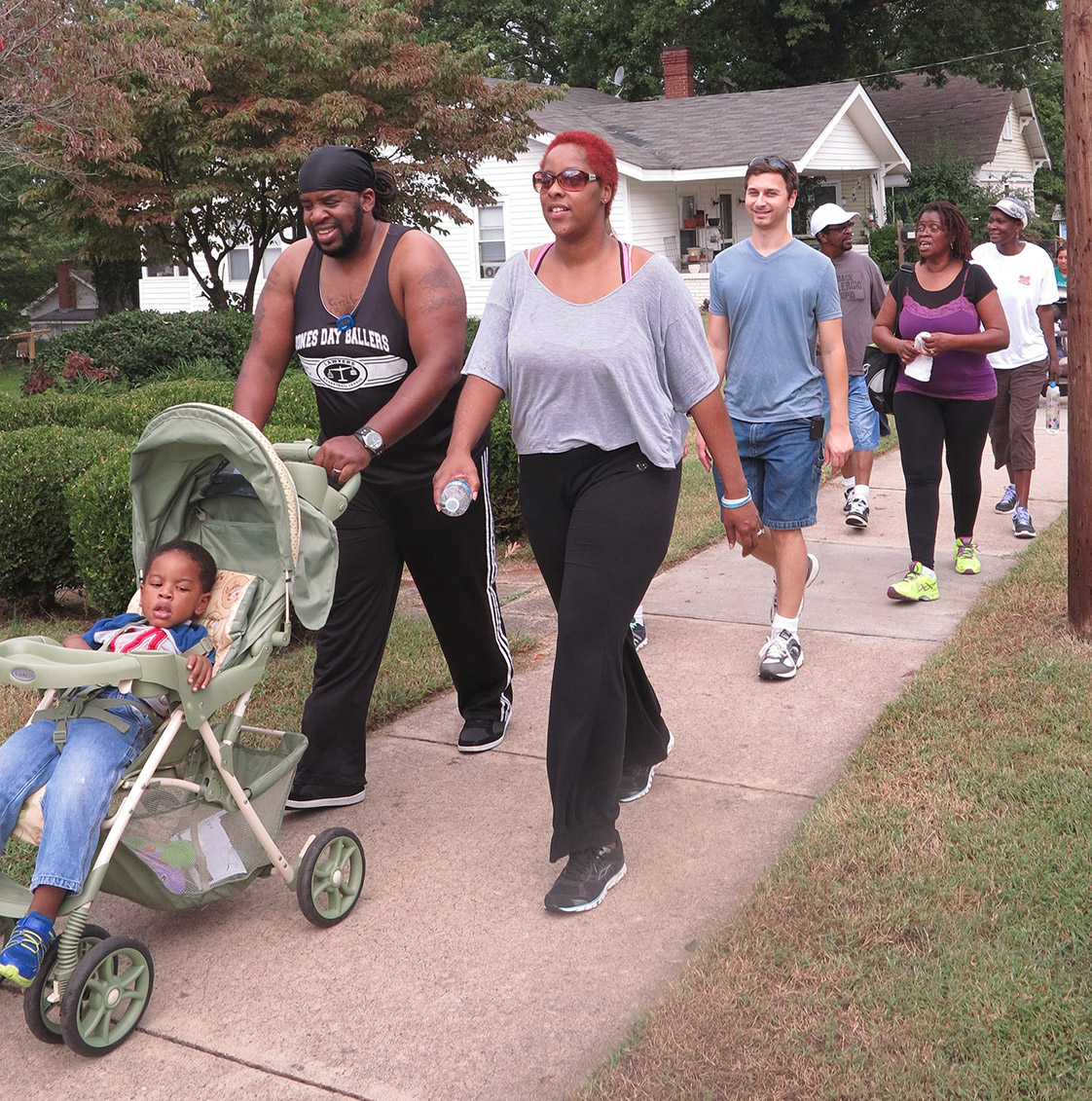 """Darryl and Lanishia Barnes and their son Jacob are """"champions"""" of the route, having walked it for two months now. They hope to be able to make it Tuesday and Thursday mornings when the group completes it, Lanishia explained, because being in a group """"helps keep you accountable."""" (Staff photo by Caitlin Ball)"""