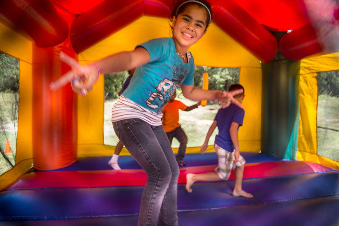 "Children were enjoying the ""bounce house"" at Durham's Latino Fest on September 27. Dariana Vargas, 18, who was the volunteer on site said, ""I like giving back to the community, [volunteering] is like giving a little happiness."" (staff photo by Robert Berges)"