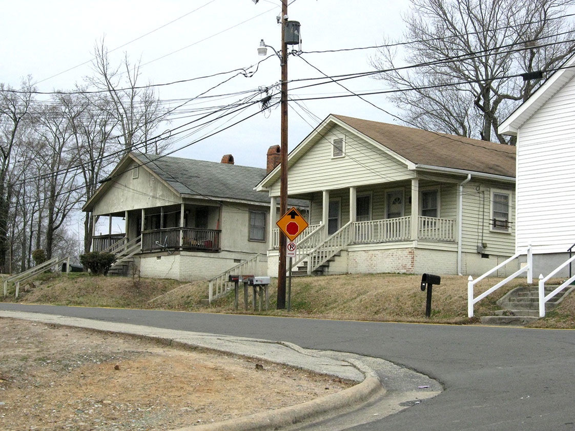 Renovated homes and homes in need of repair stand side by side on West Enterprise Street, a common sight in the Southside neighborhood.