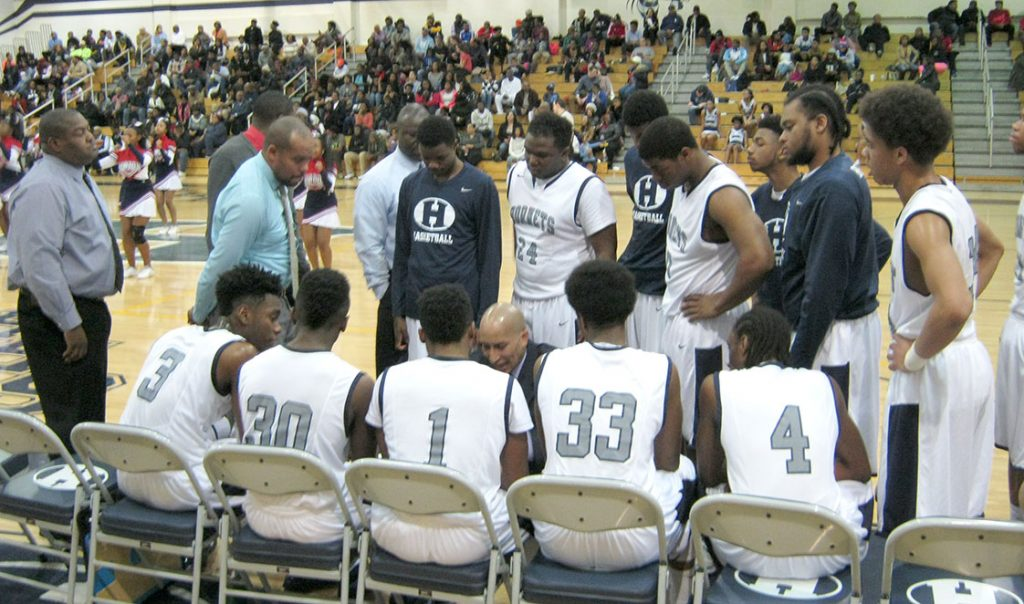 Hillside High School senior guard Robert (R.J.) Robinson Jr., (far left, number 3), huddles with his teammates during a recent timeout. (Staff photo by Max Miceli)