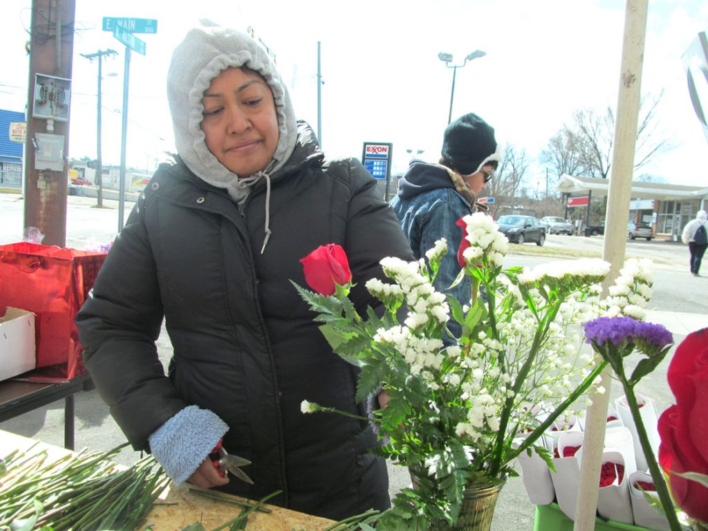 Irma Delgobo, 37, preps a vase of handpicked roses and carnations to sell at her pop-up Valentine's Day store