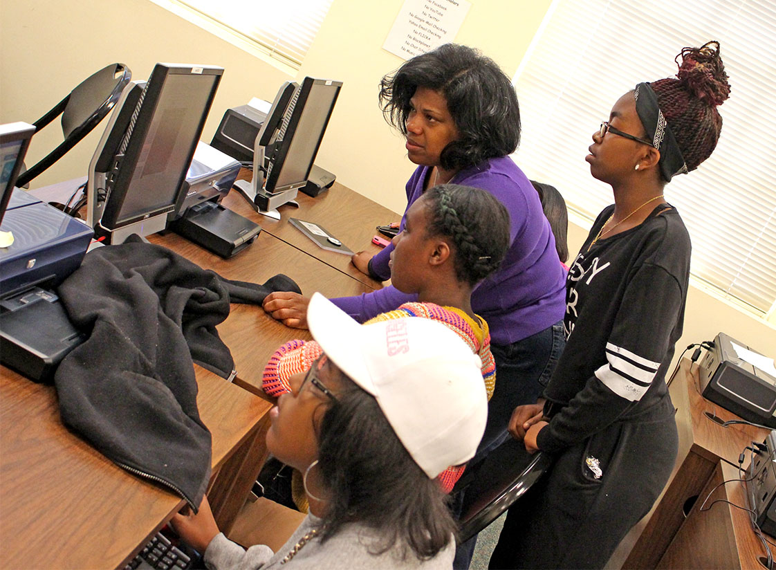 Students in the Girls Who Code program troubleshoot their code. Left to right: Madison Wheaton, Dakota Dats, Taylor Ashley (Photo by Quentin Atkinson)