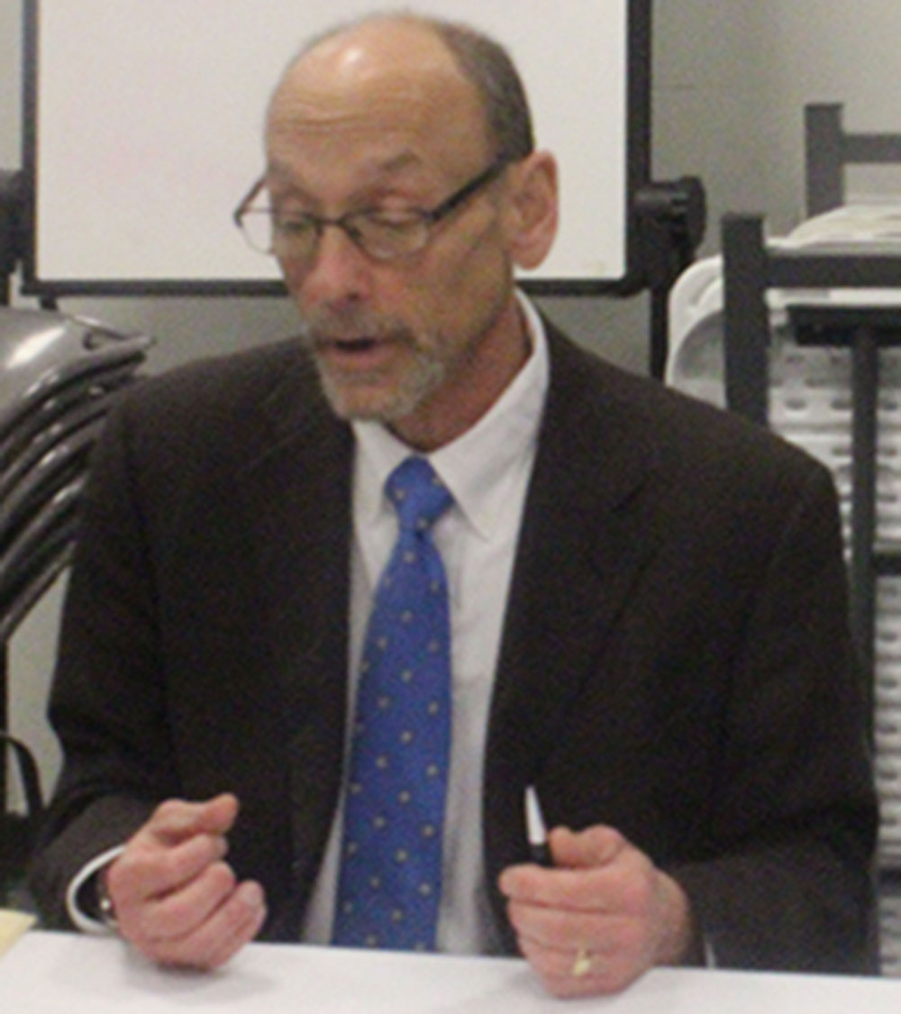 """Professor Kenneth Janken discusses his book """"Wilmington Ten"""" at an event on Feb. 21 at the Durham Public Library. (Staff photo by Rowland Givens)"""