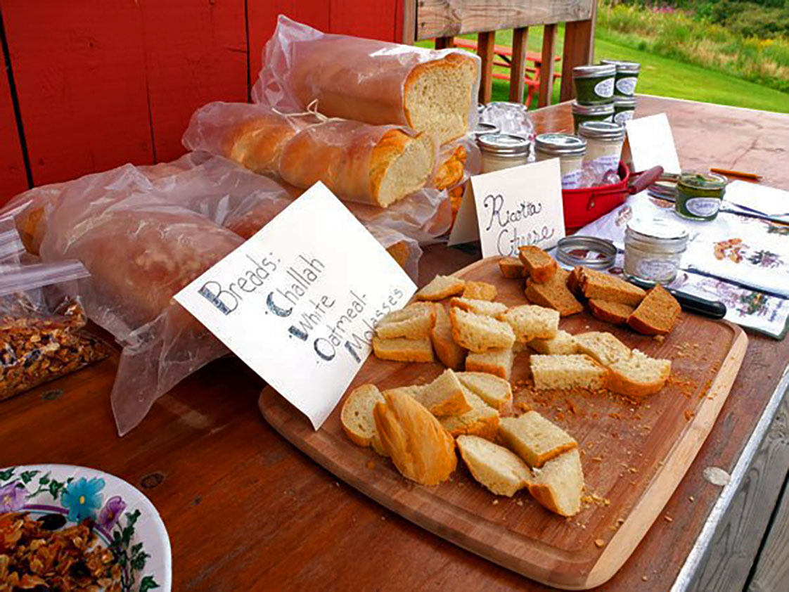 """Bread is set up for sampling at an Aug. 2015 Seacoast Food Swap event. Once sampled, participants can choose whether or not they want to """"bid"""" on this item."""" (Photo Courtesy of Seacoast Food Swaps and Erin Urquhart)"""
