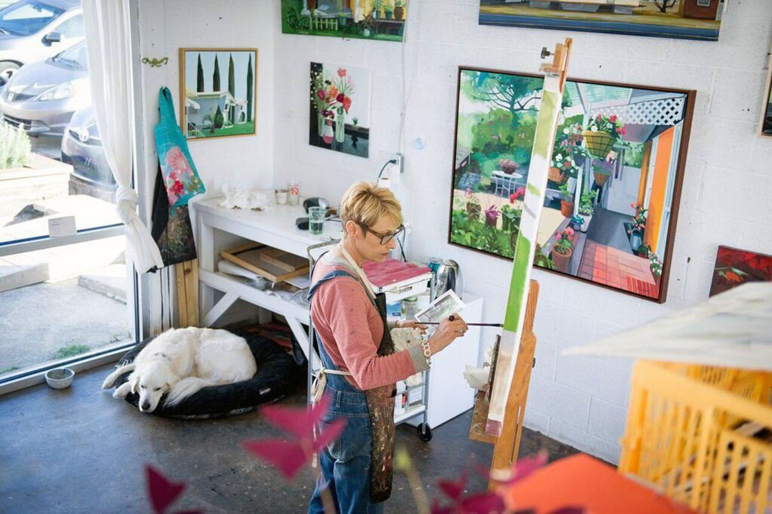 Rachel Campbell working in the studio on her latest paintings. (photo by Courtney Hayes)