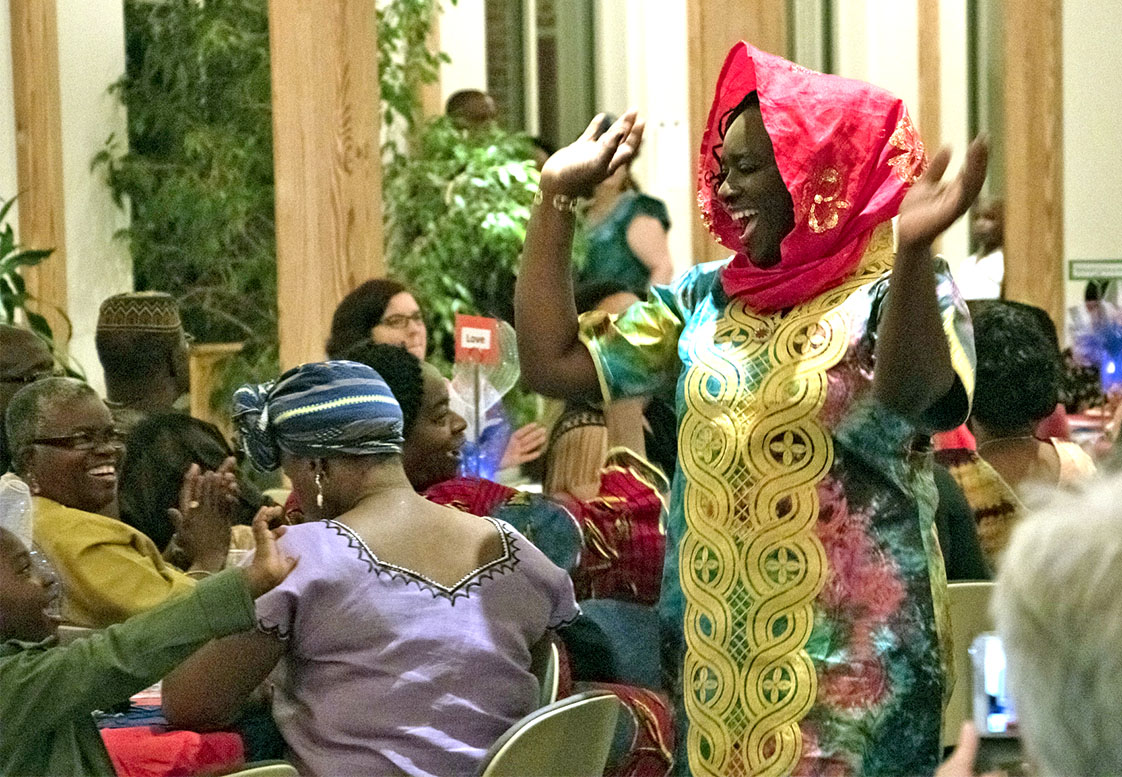 Model Lizzie Flomo smiles as she makes her way through the room rocking her outfit during the fashion show at the Liberian dinner at St. Philips on Saturday, Oct. 15. (Staff photo by Brenna Elmore)