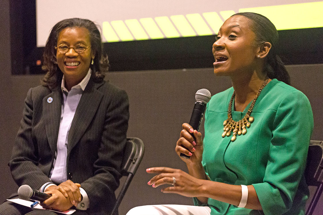 Deborah Stroman, a professor in the Kegan-Flagler Business School, and Tashni-Ann Dubroy, the president of Shaw University, speak on a panel at Black Wall Street Homecoming about the importance of women leaders in business in the Full Frame Theater on Oct. 14, 2016. (Staff photo by Rob Gourley)
