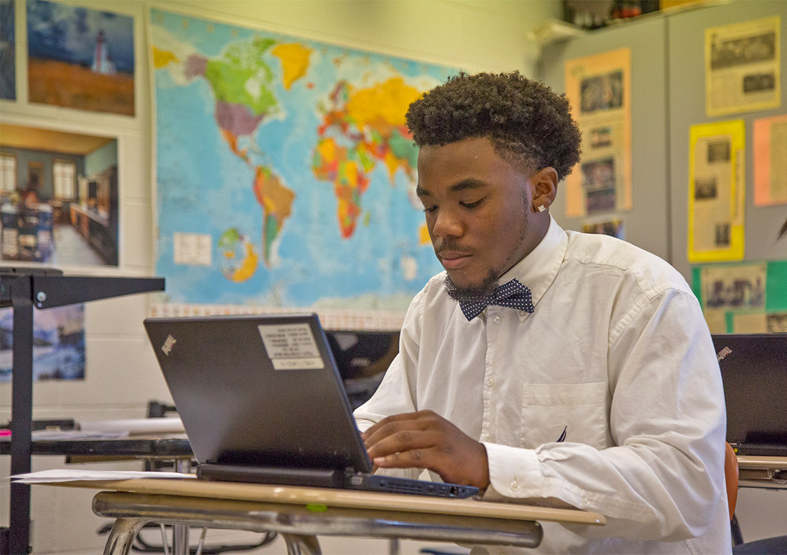Deion Williams, a senior in Hillside High School's IB Programme, works on college essays during English class on Sept. 30th, 2016. He is dressed-up because he plays football, and team members dress nicely on the day of a game. (Staff photo by Rob Gourley)