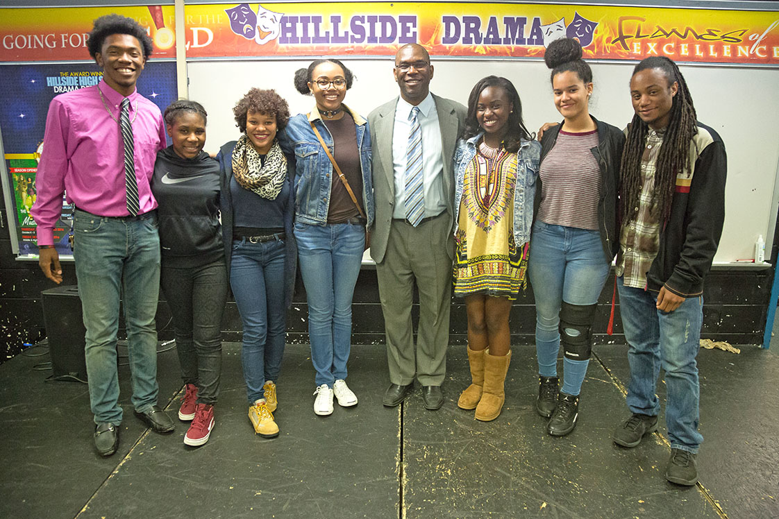 "Hillside High Theatre Director Wendell Tabb (middle) poses for a portrait with Hillside High students and ""The Wiz"" cast members Jordan Jarmon, Brianna Outlaw, Jordan Hankerson, Camryn Sherer, Bryanna Williams, Daniella Ochman, and Nasjah Batts (left to right) between classes at Hillside High School on Oct. 24th, 2016."