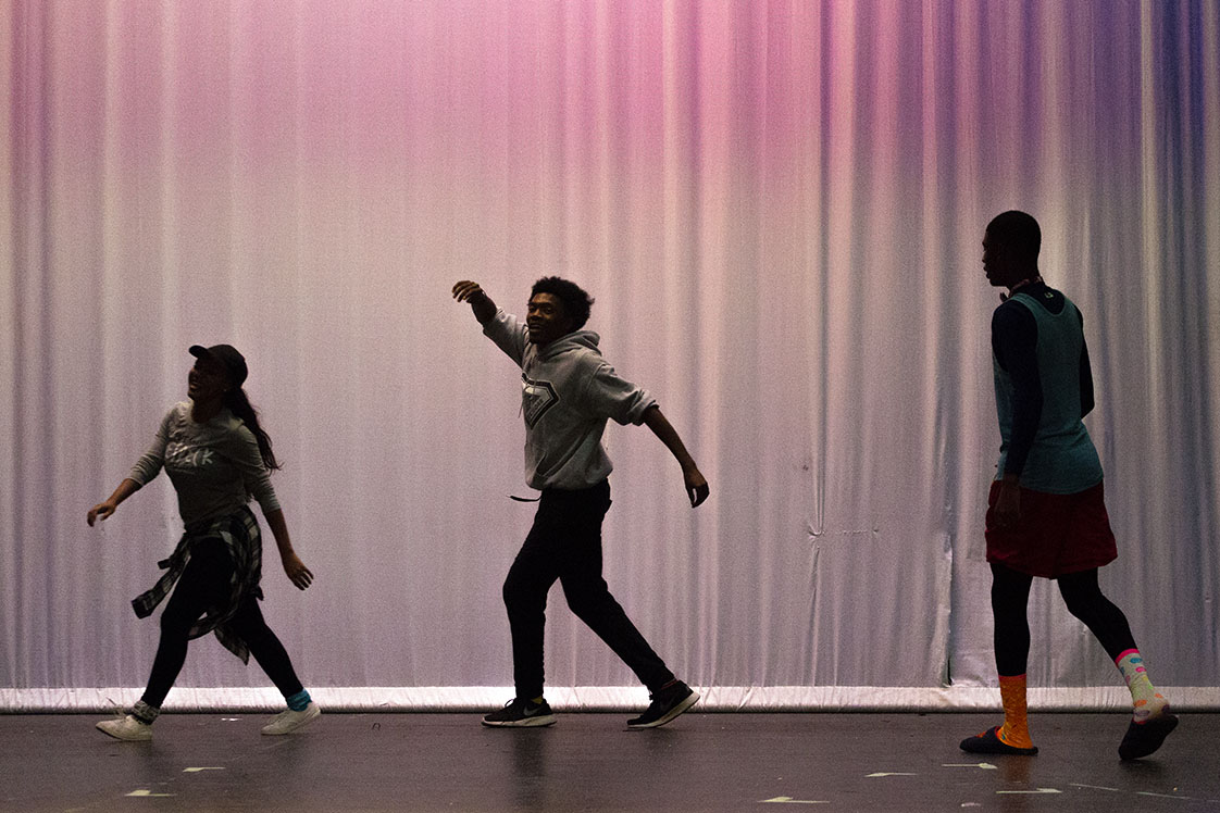 "Hankerson, Jarmon and Suiter (left to right) skip around the stage at Hillside High School on Oct. 12, 2016, while rehearsing a scene for the upcoming musical, ""The Wiz."" They will play the roles of Dorothy, Scarecrow and Tin Man respectively. (Staff photo by Rob Gourley)"