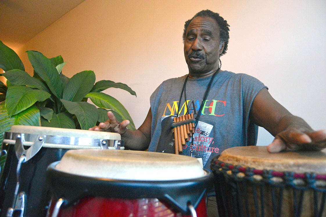 """Ken Moshesh, 70, began drumming on oatmeal containers as a child and now has developed his own percussive style that builds on pre-colonial African and Latin traditions and geometric shapes, similar to constellations. He call his drumming system """"Ameri-cosmic."""" (Staff photo by Meredith Wilson)"""