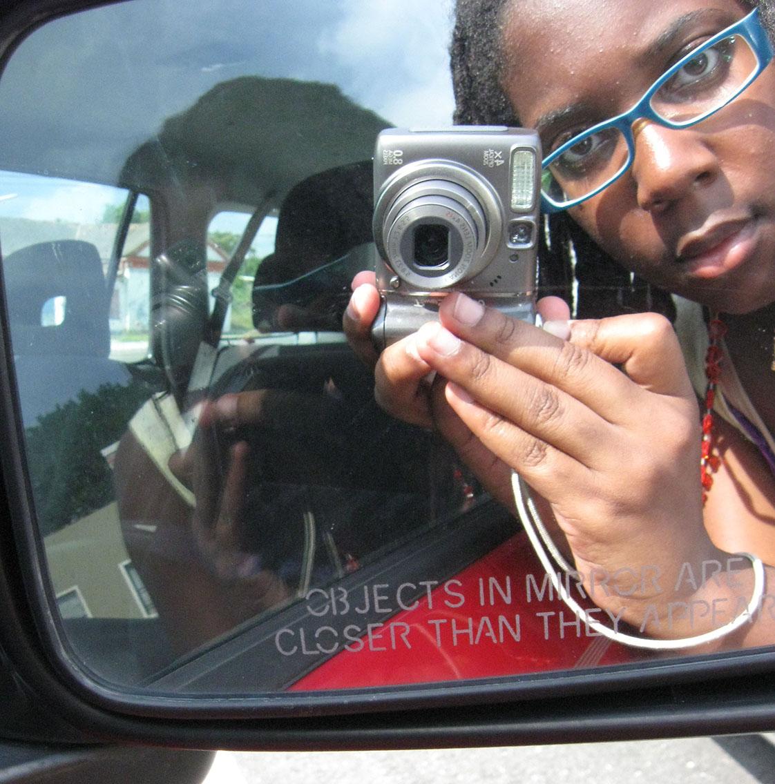 Back in 2009, Zenzele Barnes makes her own self portrait in a mirror.