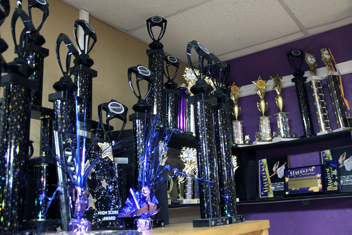A row of trophies line the shelves in the back corner of Cheryl Bellamy's backyard studio. Recently she took 20 of her top dance students to the Starbound National Talent Competition in Orlando, Fla. where they placed in the top eight out of more than 40 teams. (Staff photo by Ashlen Renner)