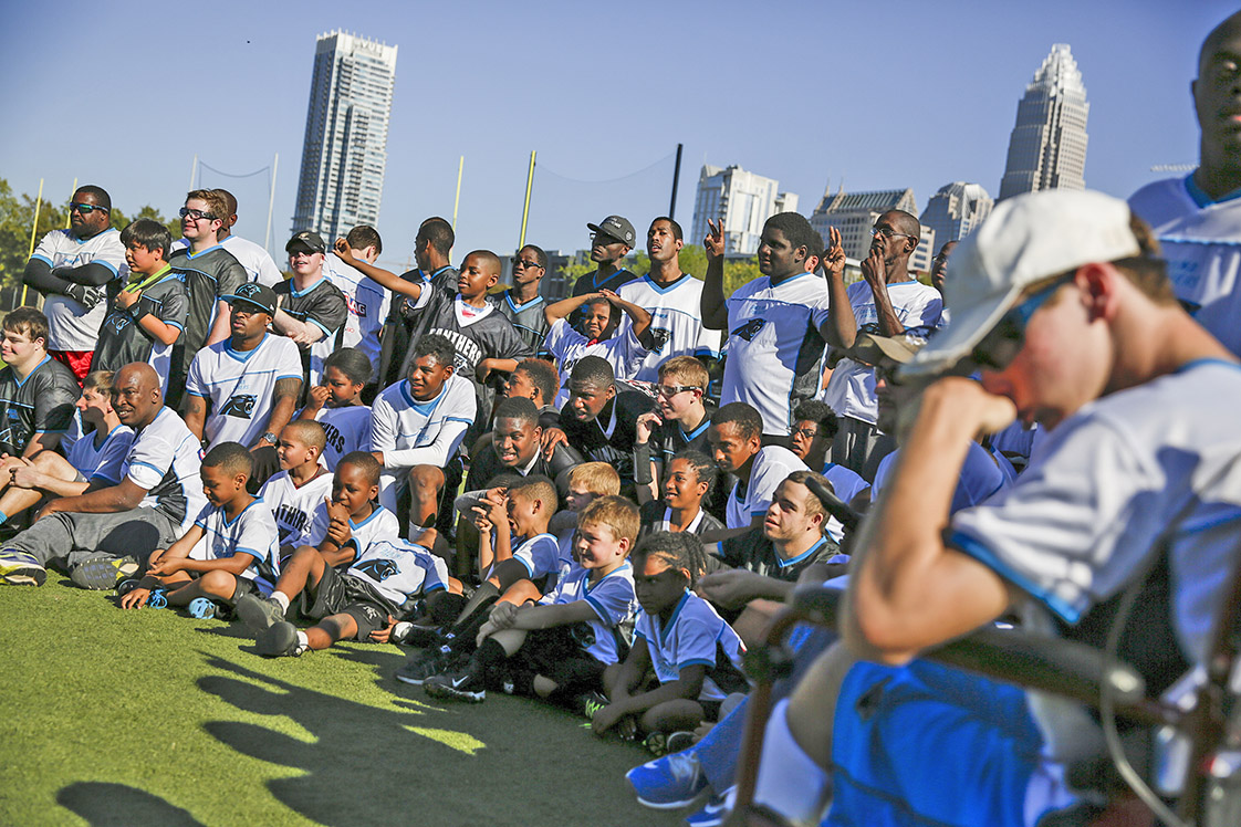 Members of the Challenger division of the Consolidated Football Federation pose for a photo after a season-ending tournament hosted by the Carolina Panthers football team.