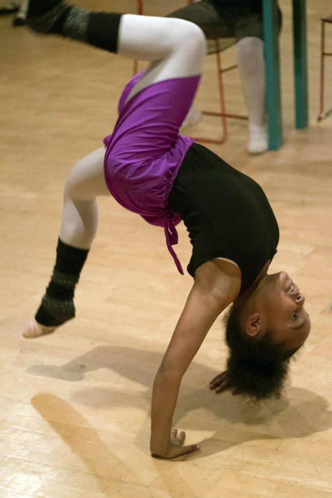 "Destiny Monroe does acrobatics in preparation for her role as Mouse Queen during one of the final rehearsals of the Walltown Children's Theatre production of the ""Durham Nutcracker"" on Tuesday, Nov. 22. (Staff photo by Brenna Elmore)"