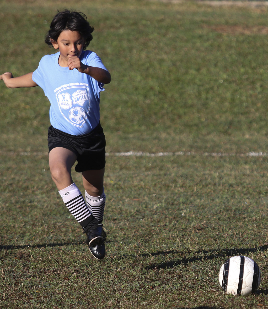 A player on the Eastway Elementary School team makes a move for the ball in their game against Merrick-Moore Elementary School on Saturday, Nov. 5. (Staff photo by Brenna Elmore)