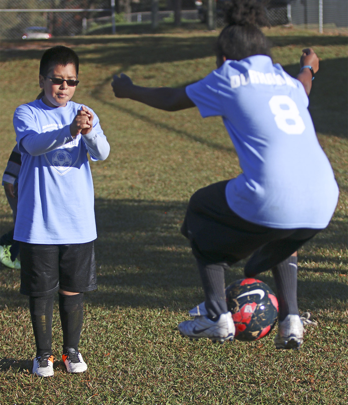 Teammates Kayden Sims and Juan Arenas-Villalobos goof off on the sidelines while the rest of their Eastway Elementary School team takes on Merrick-Moore Elementary School as a part of the Police Athletic League on Saturday, Nov. 5.