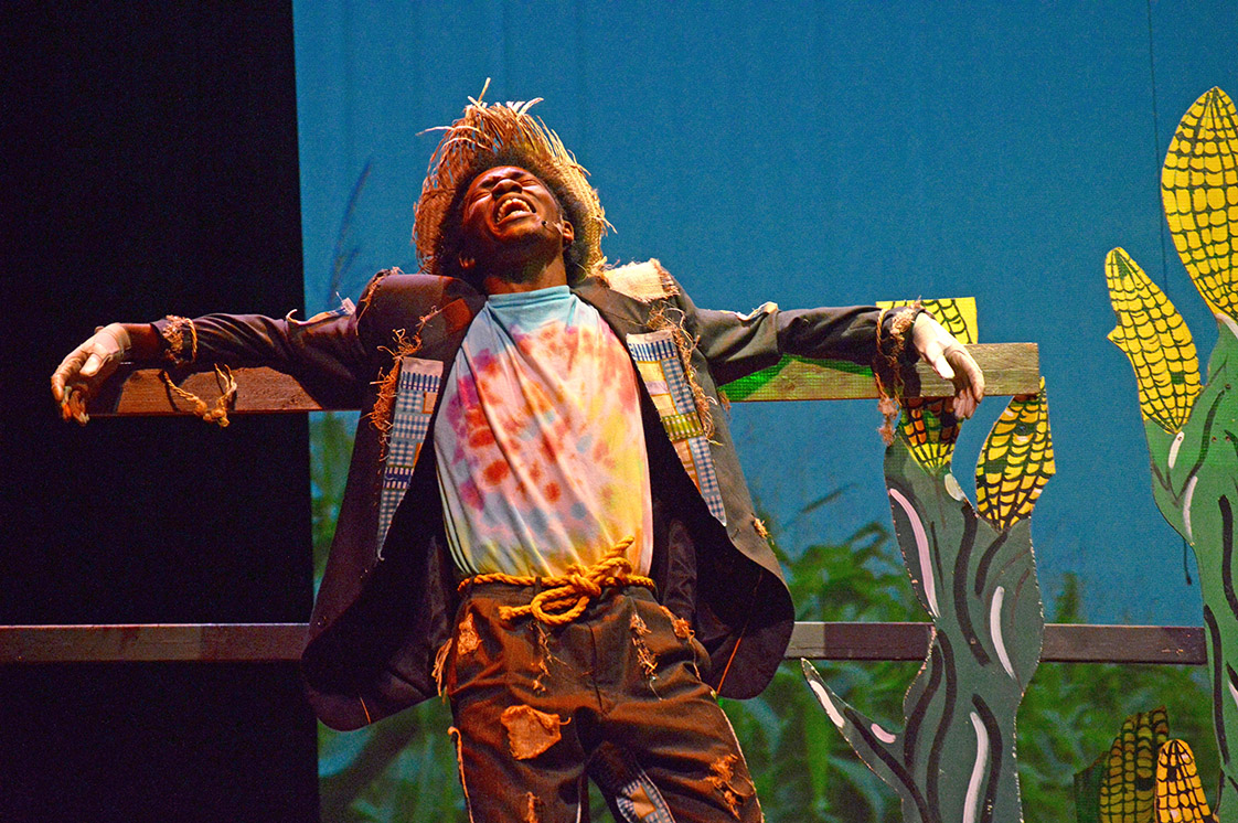The scarecrow, played by Jordan Jarmon, cries out for help from Dorothy, who was passing the corn field during the Hillside High School production of The Wiz on November 4. (Staff photo by Meredith Wilson)