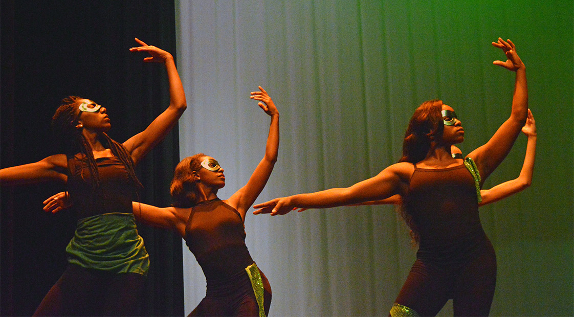 First Last, First Last and First Last perform as The Wiz's dancers in the Emerald City in Hillside High School's production of The Wiz on November 4.