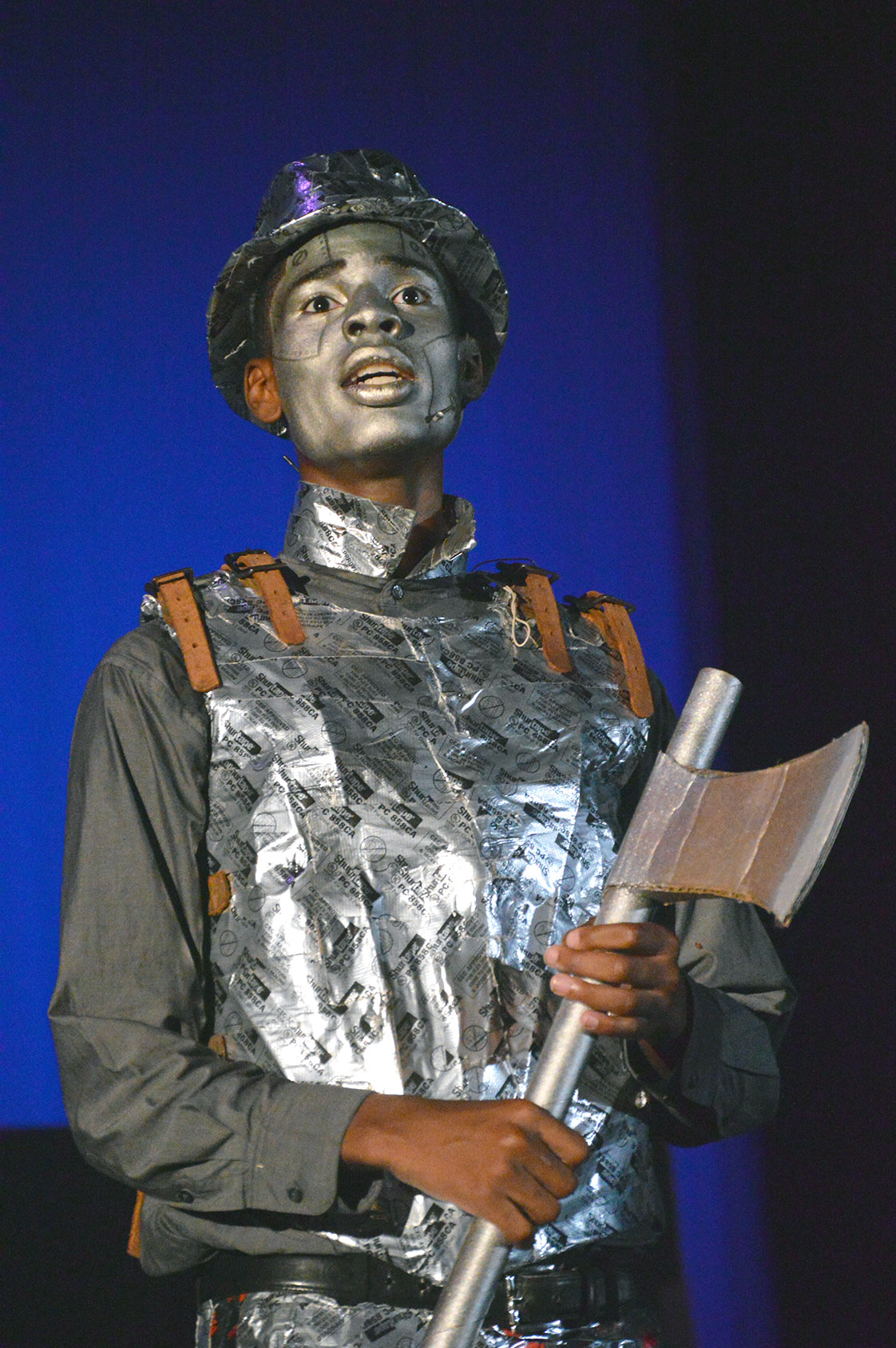 Joshua Suiter, the Tinman, sings out in happiness at the new heart he just received from the magical and mysterious Wiz, played by Justin Wright/Mario Criss (waiting on confirmation which one). (Staff photo by Meredith Wilson)