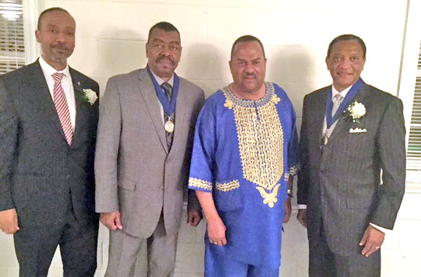From left to right: Dr. Charles Johnson, the first African-American faculty member at Duke Medicine, Frank Brown, Pastor Michael Page and James Speed, former president of North Carolina Mutual Life Insurance Company gather for last year's celebration. (Photo courtesy of Pastor Michael Page)