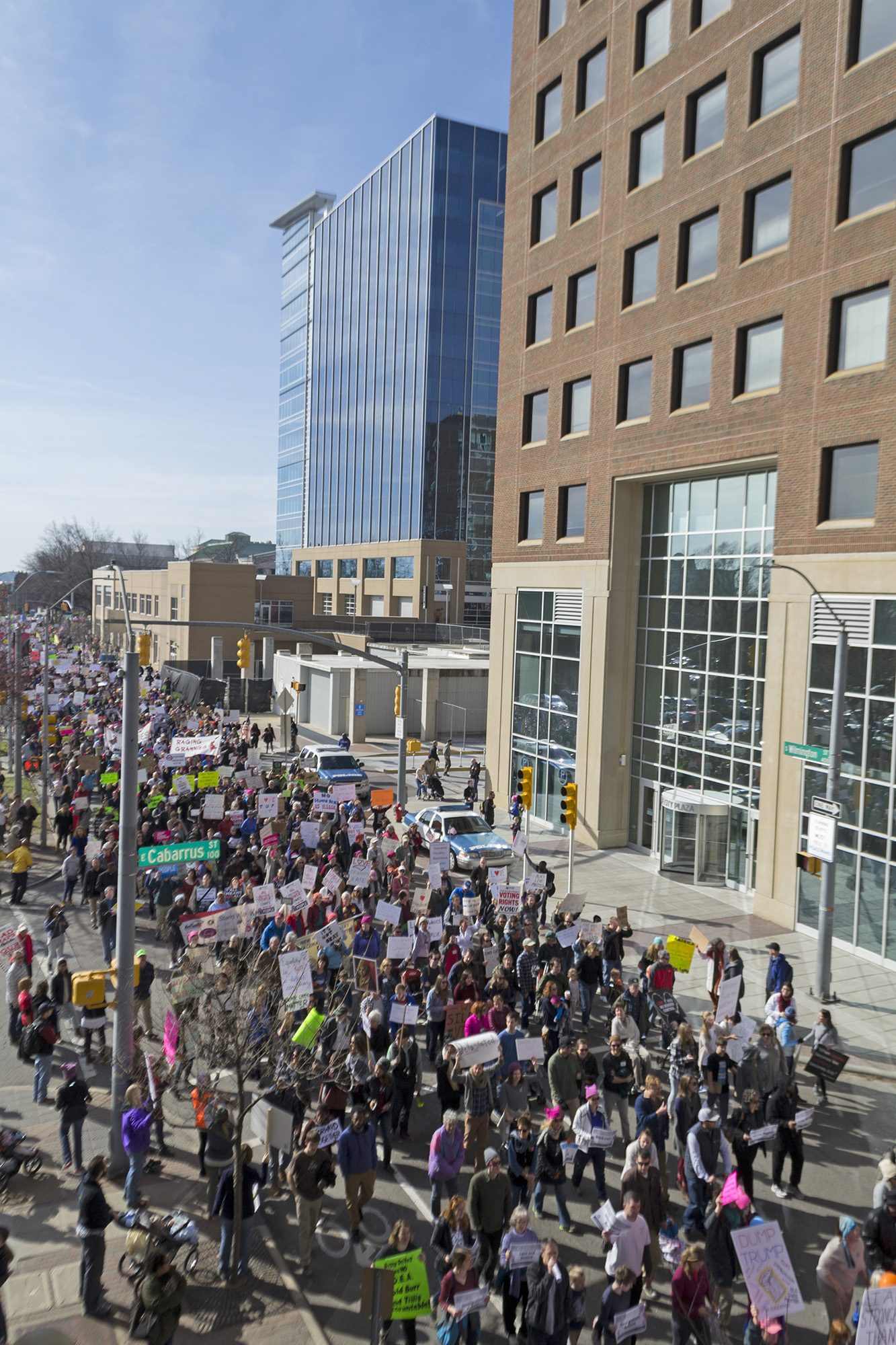 Protesters chanted as they marched down South Wilmington Street, making their way from the Duke Energy Center for the Performing Arts to the State Capitol in Raleigh. (Photo courtesy of Lauren Groffsky)