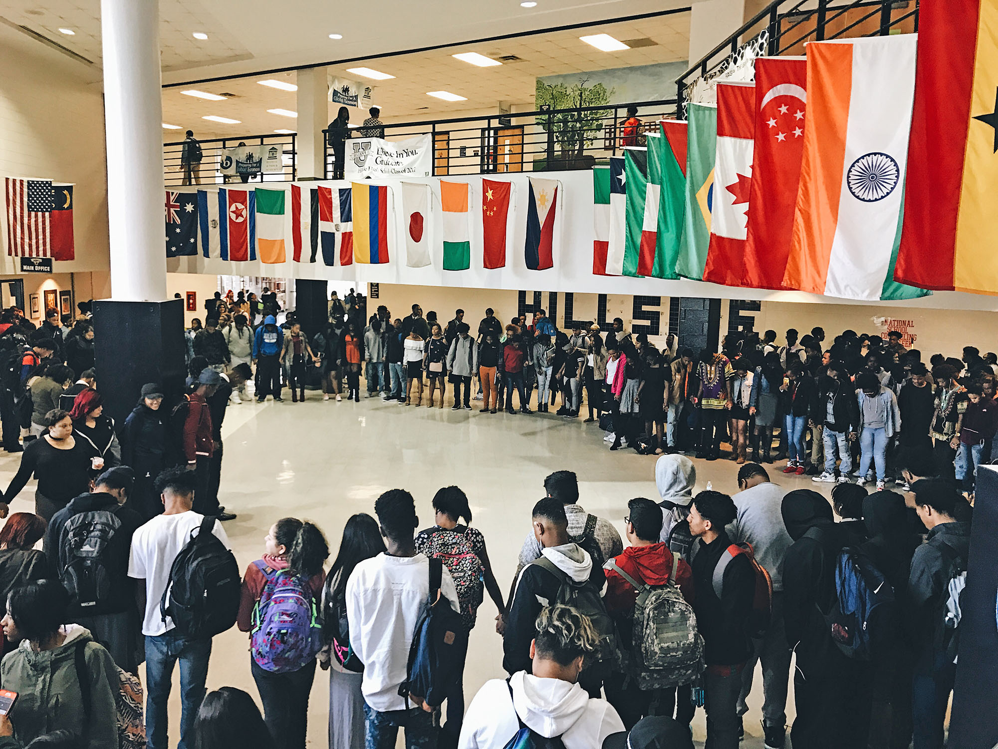 A moment of silence and reverence to start the day in the otherwise bustling lobby of Hillside High School. (Photo courtesy of Daniel Gwyn)